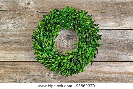 Green Boxwood Leaf Wreath On Rustic Wood