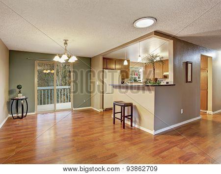 Nice Sized Dinning Room With Hardwood Floor.