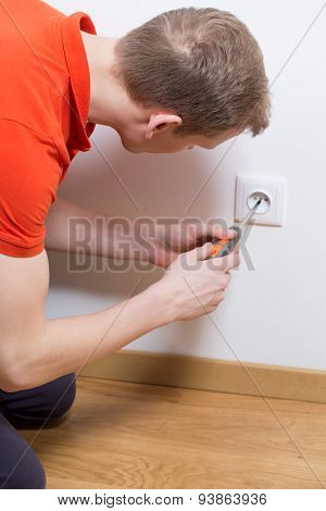 Man Repairing Electrical Socket