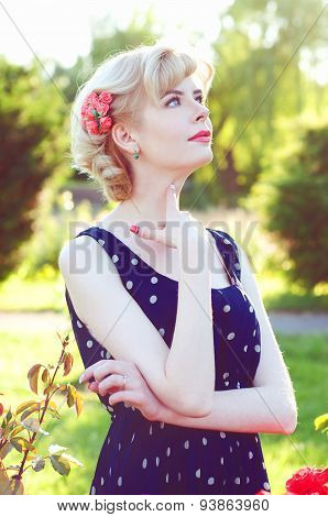 Beautiful Blonde Woman In Blue Dress  Posing In Garden