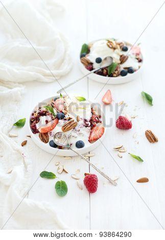 Healthy breakfast. Berry crumble with fresh blueberries, raspberries, strawberries, almond, walnuts,