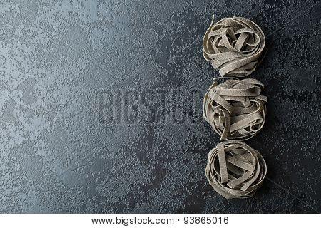 top view of black tagliatelle pasta