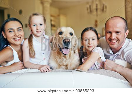 Pet surrounded by family members