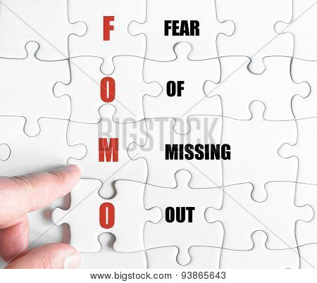 Last Puzzle Piece With Business Acronym Fomo