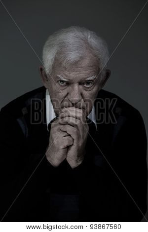 Sad Senior Man Praying
