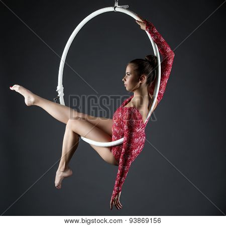 Image of sexy acrobatic girl posing with hoop