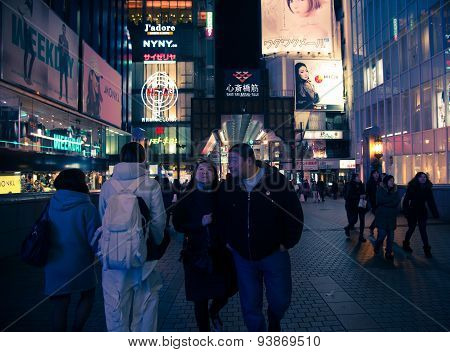 Urban Scene At Night In Osaka , Japan