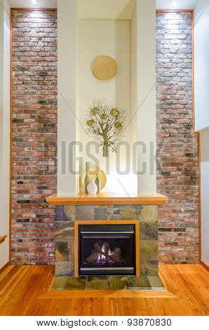 Interior design of a luxury living room with a brick wall and fireplace.