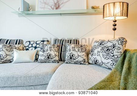 Living room Interior with couch, sofa and colorful designer cushions, pillows.