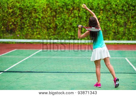 Young active woman playing tennis on tropical vacation