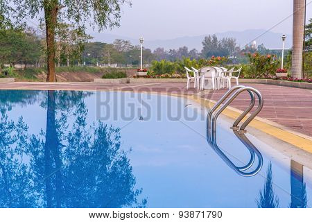 Luxury Swimming Pool With Plam Tree In Morning