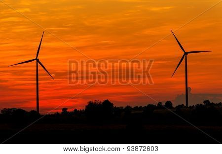 Eco Power In Wind Turbine Farm With Sunset