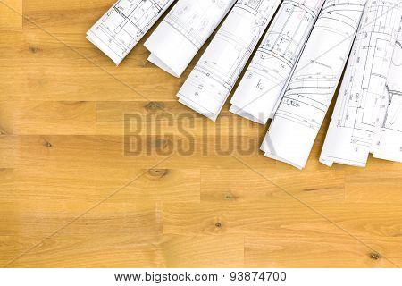 Stacked Rolls Of Architectural Drawings And House Plans