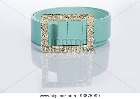 thin green female belt buckle with fine