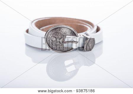 white Women's belt with rhinestones