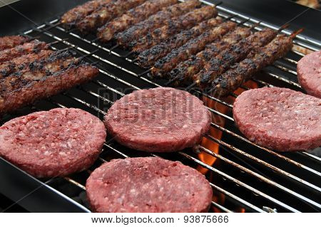 Burgers cooking on home barbecue.