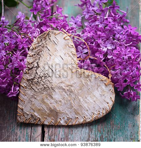 Postcard With  Decorative Heart And Fresh Lilac Flowers