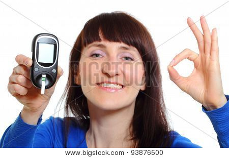 Smiling Woman With Glucose Meter On White Background