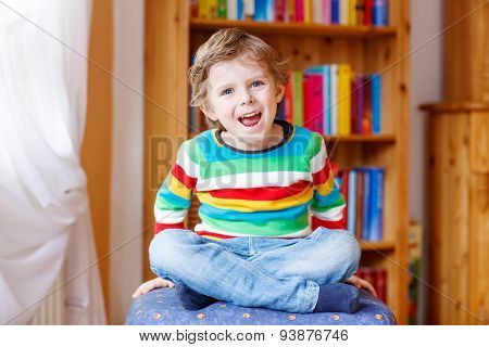 Little Blond Kid Boy Having Fun And Smiling, Indoors