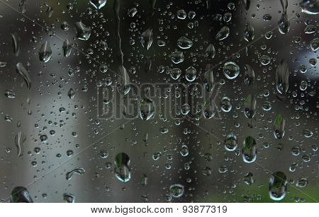 Dripping Down Drops Of Rain On Glass