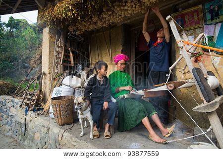 Unidentified H'mong ethnic minority woman is weaving