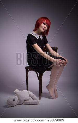 Girl With Doll In A Gloomy Atmosphere