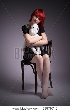 Vintage Girl With Doll Sitting Chair