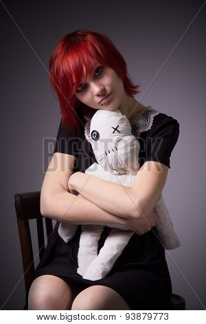 Red-haired Girl And Doll On A Chair