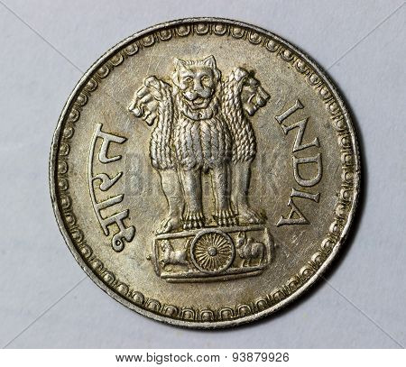 Indian emblem depicting three lions in the front on a big antique coin
