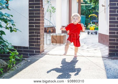 Little Toddler Baby Boy Making His First Steps Outdoors