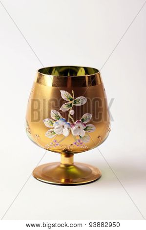 Empty Ornate Golden Vine Goblet Glass