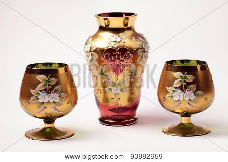 Red And Gold Ornate Glass Vase And Vine Goblet Glasses