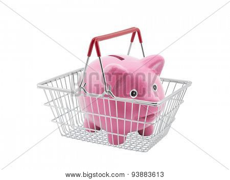 Shopping basket with piggy bank on white background