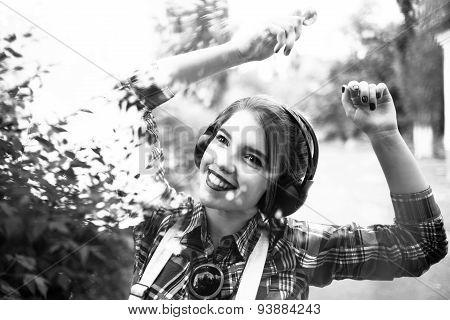 Hipster Girl Enjoying Music On Headphones And Dancing.