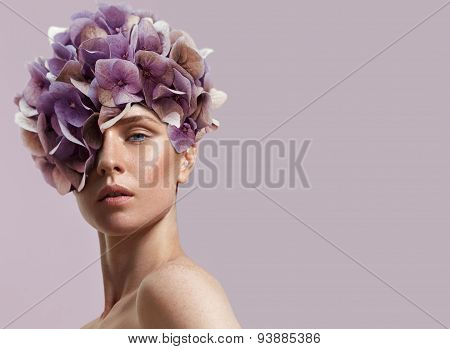 Beauty Woman Watching Flowers On Her Head