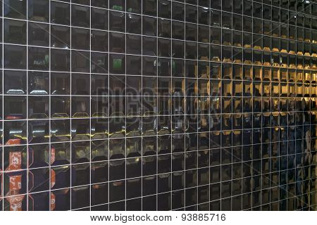 Shiny Wall Of Black Convex Square Tiles With Polished Mirror Reflective Surface