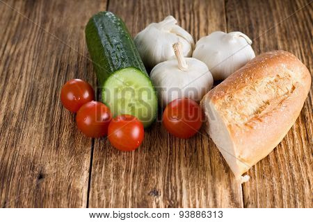 Piece Of Baguette Together With Various Vegetable