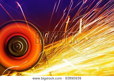 Sparks from circular saw