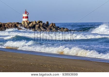Ocean View And Small Lighthouse In The Inlet Jetty Of Tavira Island, Algarve