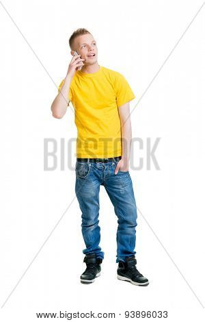 Teenage boy talking on the phone isolated on white