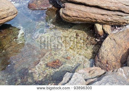 Metamorphic pebbles and boulders underwater
