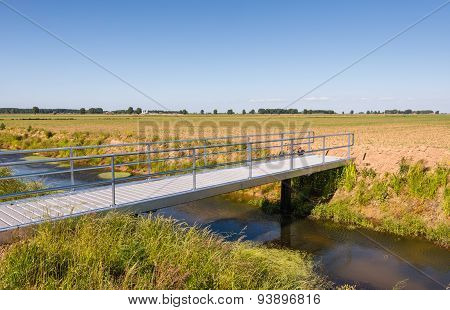 Small Aluminium Bridge Over A Stream