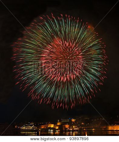 Big colorful fireworks explode in Malta in dark sky,Malta fireworks festival, 4 July, Independence