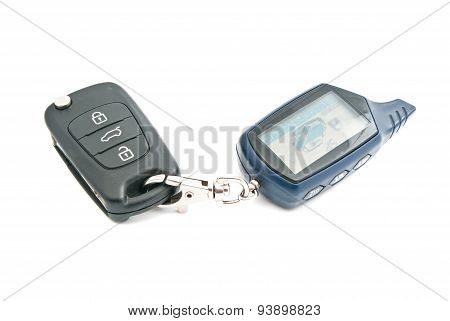 Car Keys And Alarm System On White