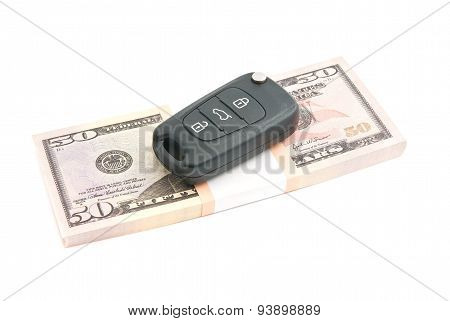 Fifty Dollars Banknotes And Car Alarm On White
