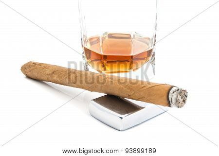 Cigar, Lighter And Cognac On White