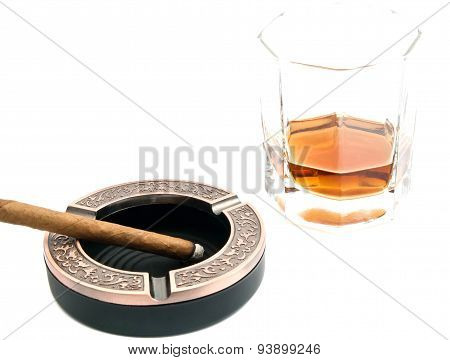 Cigarillo In Ashtray And Alcohol On White