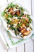 pic of rocket salad  - Zucchini rocket feta and nut salad on plate - JPG