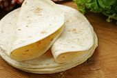 stock photo of whole-wheat  - stack of homemade whole wheat flour tortillas on a wooden table - JPG