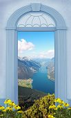 stock photo of bavarian alps  - view through arched door lake view in the bavarian alps - JPG